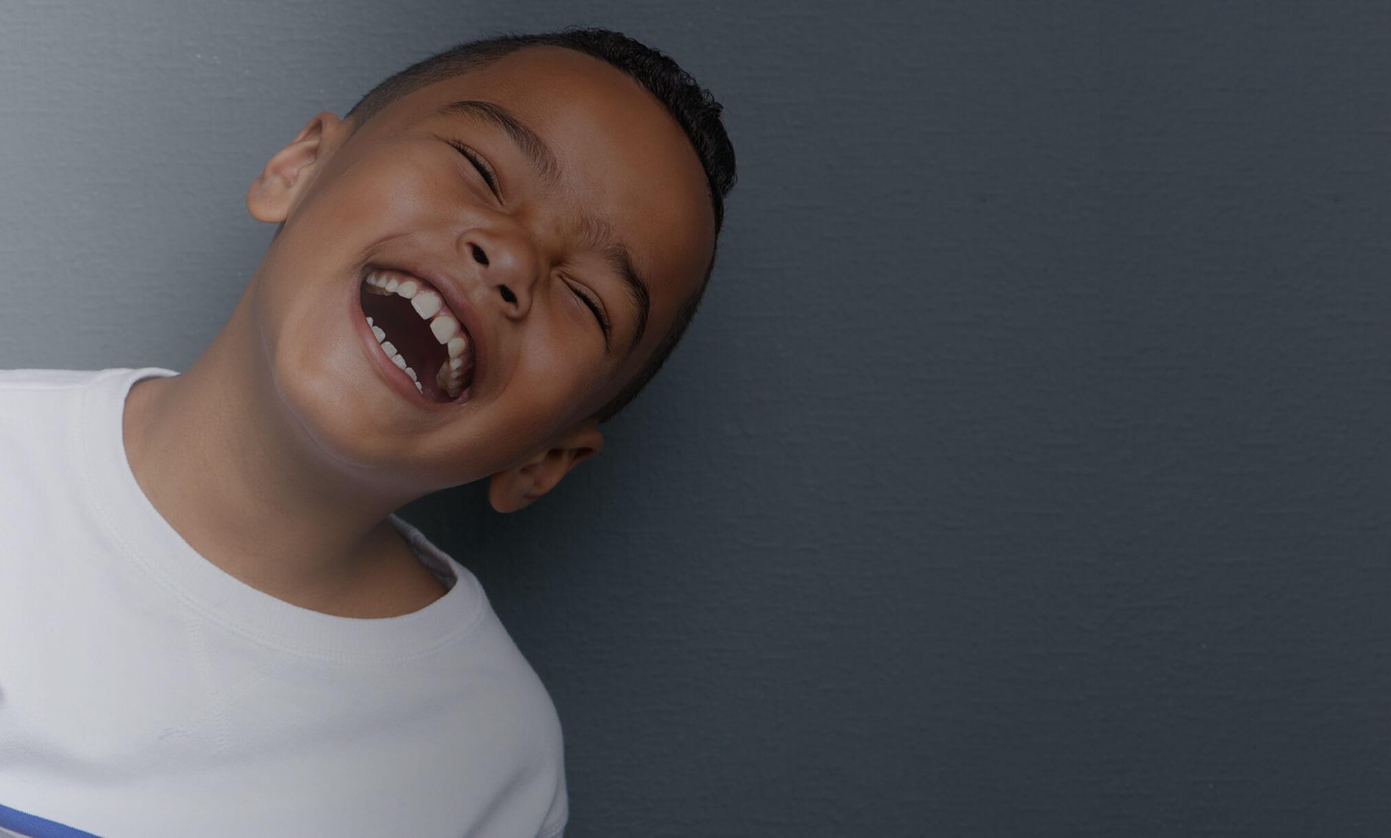 Clinique dentaire Rosemont - Jeune garçon rieur slider3